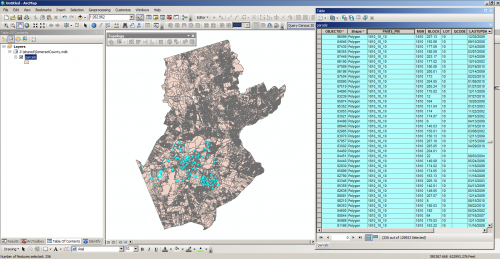 screenshot of ArcGIS with some incorrect parcels selected